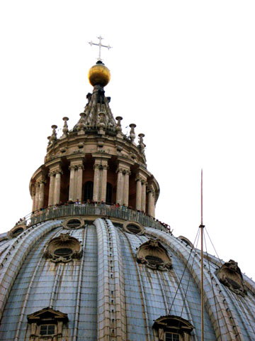 Vatican City: The main dome of St. Peter's Basilica; note the tourists