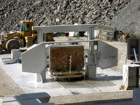 Carrara: A machine used to cut slices of marble (for counter tops, etc.); a cable containing pieces of industrial diamond works its way through a block of marble at a rate of roughly one inch per hour