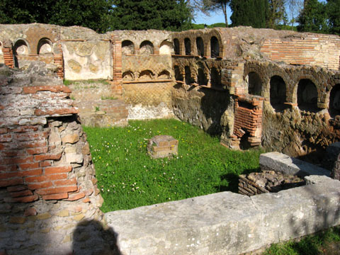 Ostia Antica: A tomb along the road leading into the city; the niches once held urns full of ashes