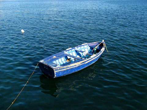 Naples: A small boat floating in the Gulf of Naples