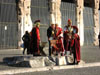 Rome: Men dressed up as ancient Romans talking to a tourist outside the Colosseum