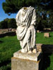 Ostia Antica: A headless statue beside the road